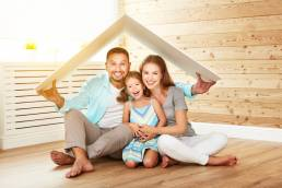 a husband, wife and daughter in their new home