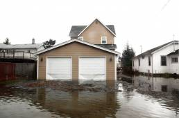 garage view of a flooded home