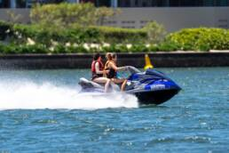 two people riding a jet ski in water